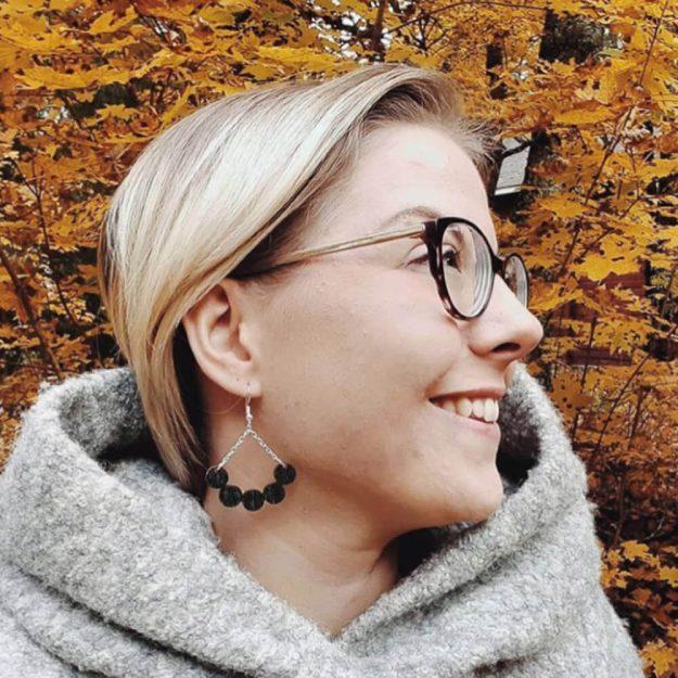 Wooden Little Rowan Earrings in a woman's ear